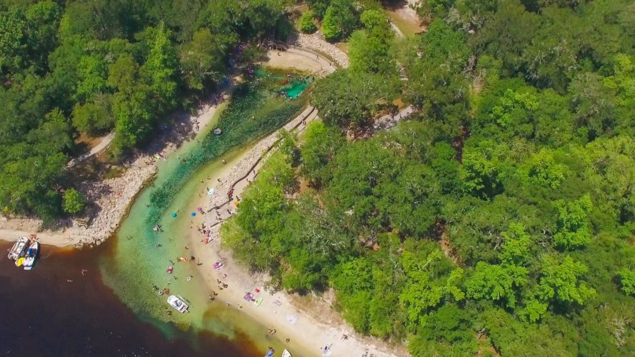 aerial view of boaters and swimmers in the Suwannee River