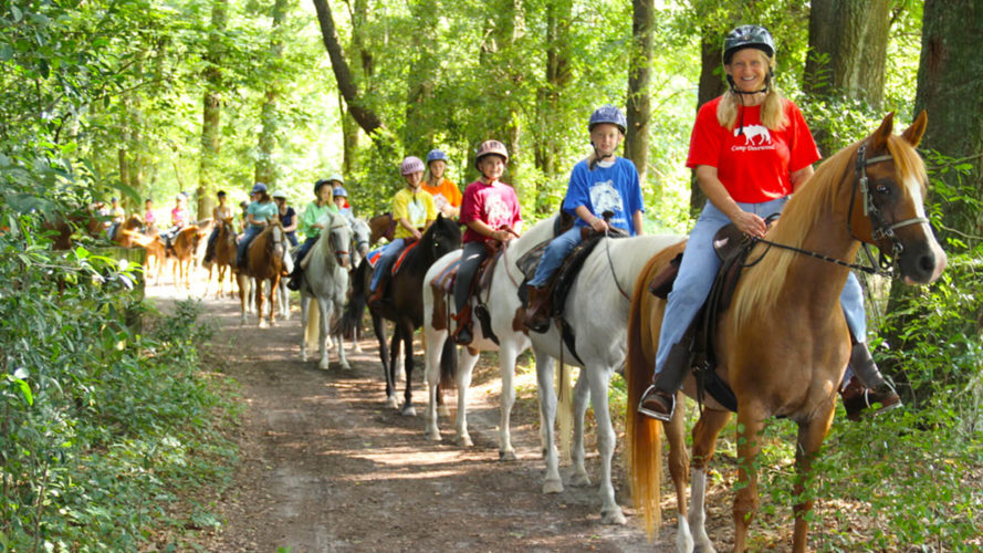 kids riding horses at camp dovewood in suwannee county florida