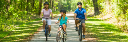 family biking in trail at suwannee park