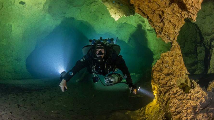 man cave diving in scuba gear at wes skiles peacock springs in florida