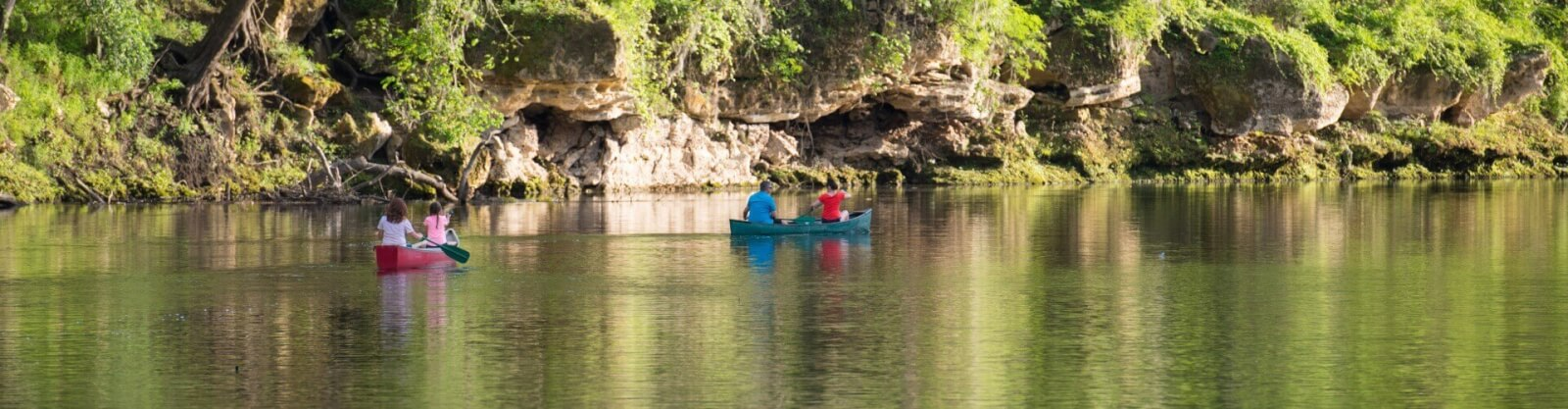 Family in canoes on the Suwannee River